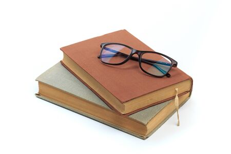 vintage old hardcover books with glasses on white background - Image