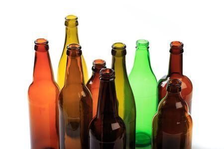 set of empty beer bottles on white background Imagens