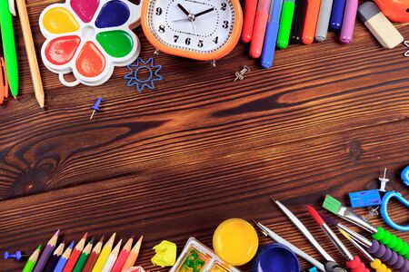 Back to School background concept. School supplies on a wooden background. Education background concept with copyspace.Top view. Back to school