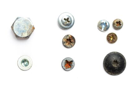 Screw heads, nuts, rivets isolated on white. - Image