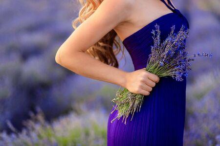 Beautiful girl on the lavender field. Beautiful woman in the lavender field on sunset. - Image