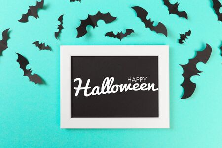 Halloween paper decorations on pastel blue  background. Halloween concept. Flat lay, top view, copy space Banco de Imagens