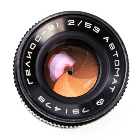 Vintage camera lens  isolated on white background .The diaphragm of a camera lens aperture Banco de Imagens