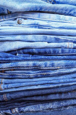 Jeans trousers stack closeup background texture Banco de Imagens