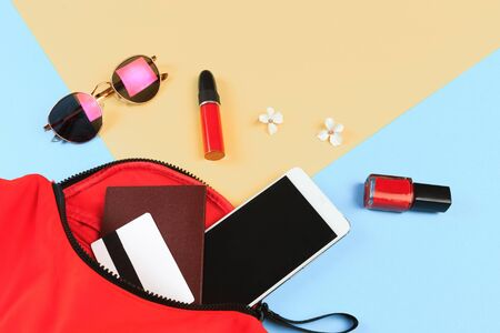 Top view of Women bag and lady stuff with copyspace on colour  background