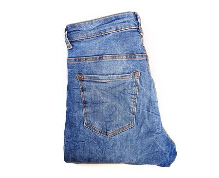 folded jeans isolated on white background.