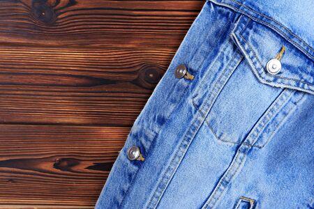 blue denim jean jacket  on wooden background - Image
