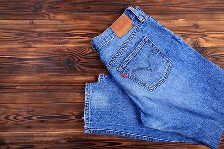 blue denim jeans  on wooden background - Image