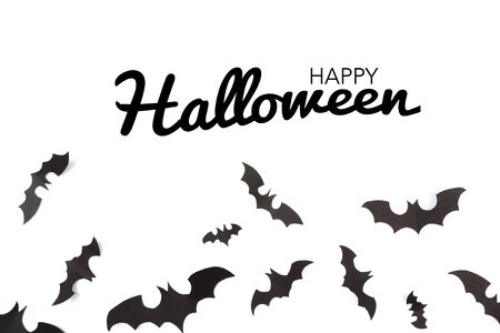 Halloween paper decorations on white background. Halloween concept. Flat lay, top view, copy space
