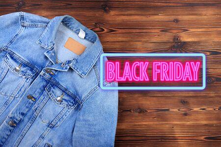 blue denim jean jacket  on wooden background . Black friday sale- Image Stock fotó