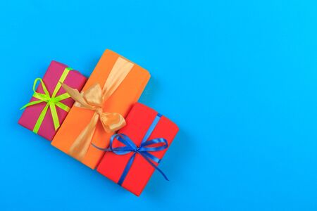 Different colored gift box on color background. Top view of various present boxes on minimal background. Birthday, Christmas, wedding, valentine, romantic gifts