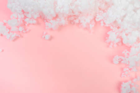 hollowfiber, polyester fiber on a pink  blue background