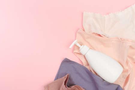 Female panties over pink  background Stock fotó