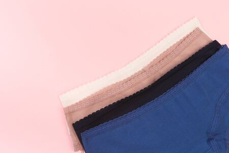 Female panties over pink  background Imagens