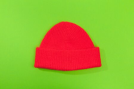 red beanie hat on green  background