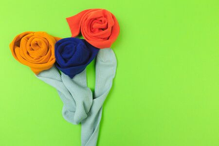 colorful socks on green background flower shaped