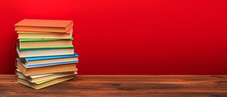 pile of old books, panorma, good copy space on red background - Image