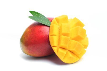 Mango fruit and mango cubes. Isolated on a white background.