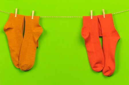 colorful   socks hanging on a rope on green   background 版權商用圖片