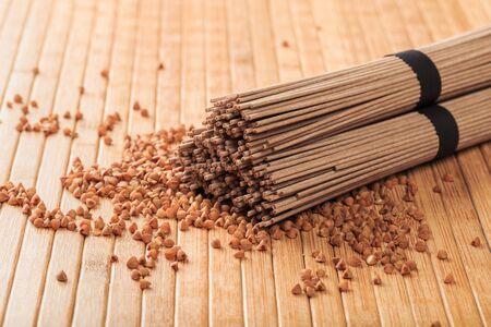 Buckwheat noodles closeup. Raw food ingredient. Dried buckwheat soba noodles. Traditional Japanese food 版權商用圖片
