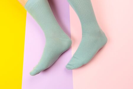 legs in colorful socks on colorful  background