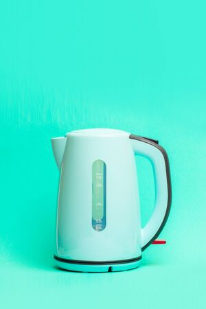 modern green electric kettle on pastel background background