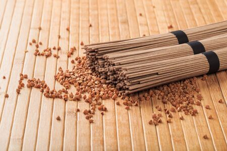 Buckwheat noodles closeup. Raw food ingredient. Dried buckwheat soba noodles. Traditional Japanese food Imagens
