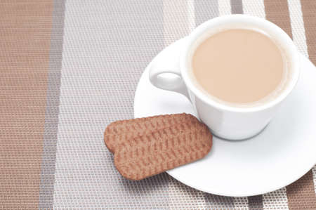 tea hot drink: Hot drink and cookies (actually tea and biscuits, but it could be any hot drink). High-key studio shot