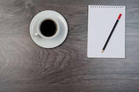 Notebook, coffee and smartphone on a wood desk. Reklamní fotografie