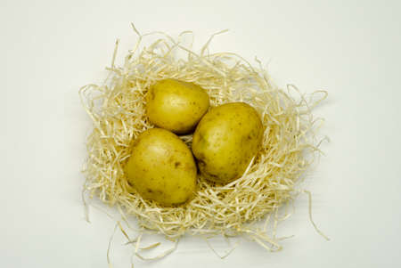 Raw potatoes, food ingredients lies in a basket. Organic foods for a healthy diet.