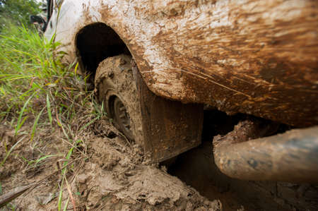 4x4 WD Car's wheels in mud in the forest, off-road Banco de Imagens