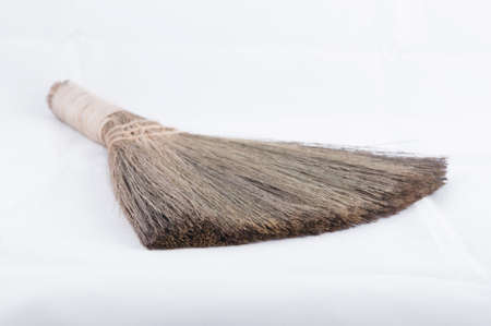 wicker work: Broom isolated on white background Stock Photo