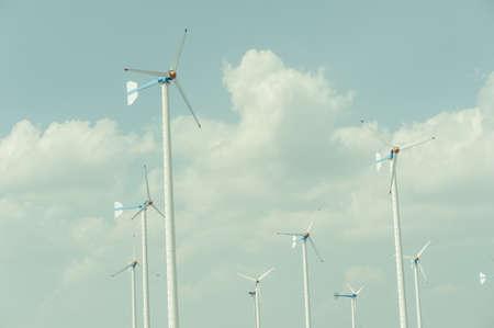 windy energy: Eco energy - wind turbines ,blue sky background