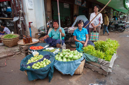 ethnology: Mandalay, Myanmar - 5 MAY 2015 . Buyer select their goods in the market.