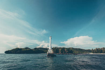 tropica: Lighthouse in the sea Stock Photo