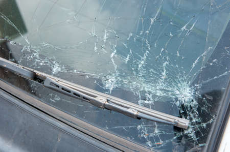 fatality: The broken windshield in car accident Stock Photo