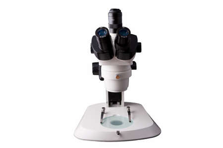 Microscope isolated on white background , This is a genuine piece of equipment that would be used in a real lab.