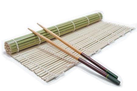 Two chopsticks on a bamboo mat background