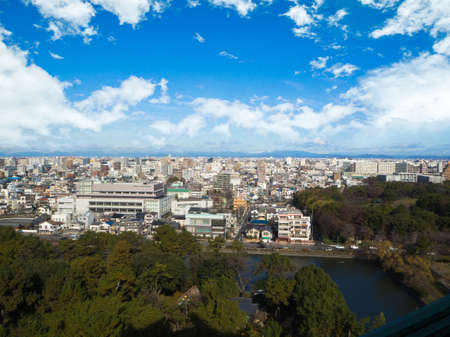 City park under blue sky with Downtown Skyline in the Background , Japan Editorial