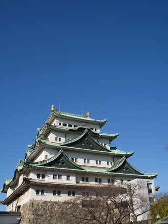 The main tower Tenshu of Nagoya Castle over blue sky