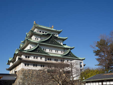 The main tower (Tenshu) of Nagoya Castle over blue sky Editorial