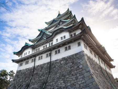 The main tower (Tenshu) of Nagoya Castle over blue sky Stock Photo