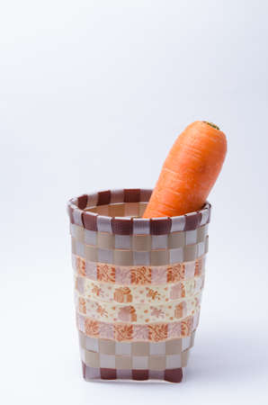 Bunch of Fresh Raw Carrot in Basket on white background
