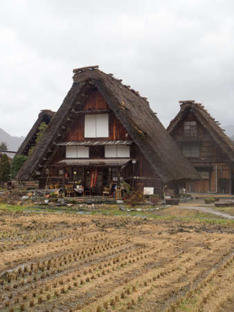 gassho zukuri: Traditional and Historical Japanese village Shirakawago, Japan - December 22, 2016 : The view of Traditional Japanese village Shirakawago in autumn season, The unique farmhouse called Gassho is world heritage of Japan