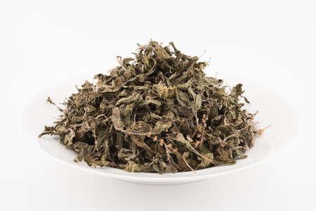 Organic dry Green or Holy Basil (Ocimum tenuiflorum) leaves on white background ,holy basil herb used in natural alternative herbal medicine