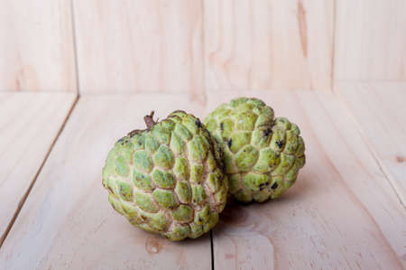 Sugar Apple (Annona squamosa L.) on wooden board, fruits of Thailand.