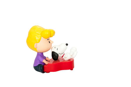 Snopy and partisan plastic toys isolated on white background  with clipping path : Bangkok, Thailand - July 18, 2016 : Snoopy and Charlie Brown plastic toys from McDonalds Happy Meal for children was on display