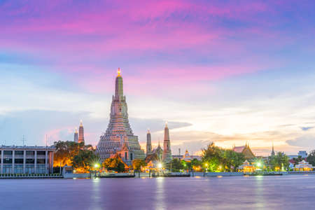 Wat Arun, along the Chao Phraya river  side with a colorful sky at  sunset in Bangkok,Thailand