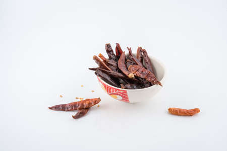 Dried red chili or chilli cayenne pepper isolated on white background , red dried chili, food ingredient for spicy cooking Stock Photo