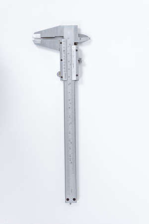 Vernier calipe or caliper. Precision measuring tools from silver steel.on a white background.